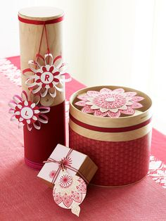 Paper garnishes -- from shapely flowers to ornate stamped medallions -- give any gift extra impact. Nontraditional containers, such as tubes and wooden boxes wrapped in coordinating papers and trimmings, make gifts more special. We'll show you how to make them.