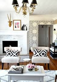 not cushions and wall design working with warm tones of floor, and shiny kick of lamps and table bases...