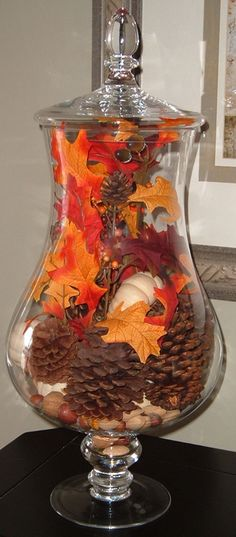 From StyleBurb: Autumn In A Jar - decorate a nice apothecary jar for each holiday.