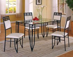 Black and White Glass Top Dinette. $198 for table and 4 chairs. AMERICAN FREIGHT.