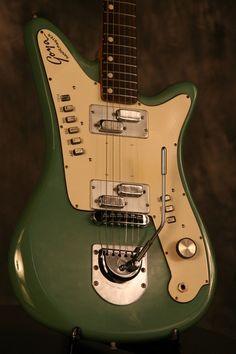 Goya Rangemaster. I think oldee guitars with loadsa strange buttons are cool.