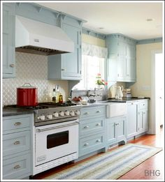 Didn't think I would, but I love the white stove! Also great cupboard details and colors
