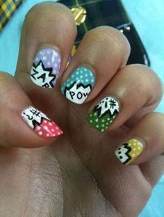 Comic Book Manicure: Looking for a way to get your non-fangirl bridesmaids to embrace your comic book themed wedding? These colorful nails go great with any bridal attire, especially a little black dress.