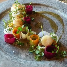Pickled Root Vegetables, Ox Bone Marrow with a Brown Butter and Oxtail Sauce - one of the exquisite dishes we sampled at Noma (Copenhagen).