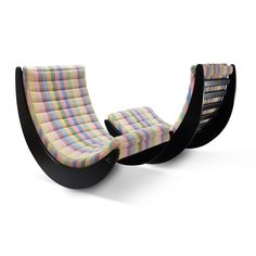A pair of Relaxer II chairs designed by Verner Panton, produced by Rosenthal, Germany. These rocking lounge chairs have still their original cotton fabric and are in great shape, with difficult to notice wear on the wood. They provide a very comfortable seat, and are a true eye-catcher in any space
