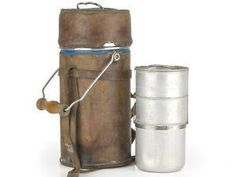 A very unusual and rare WWII period British Officer in the Indian Army canteen. The canteen looks like a huge Thermos flask in tinned steel, which has been covered in brown leather in order to make it look like Army Officers kit. Inside there is a stacking set of three aluminium canteens. The system is similar to the drum canteens used by factory workers in present day India.