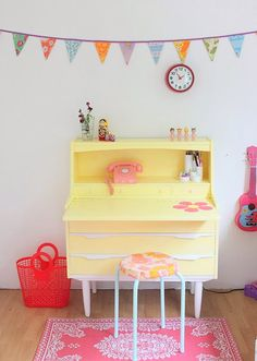 Yellow bureau/desk combo in a pretty, vintage inspired girl's room.