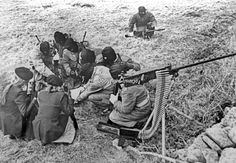 Provisional IRA border unit on maneuvers in South Armagh, N Ireland, February 1977. The men and women volunteers are seen using a variety of weapons i.e. a 50 mm Browning machine gun, a 30 mm machine gun and other automatic weapons. 1977.....P