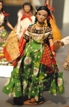 La Choquita Doll.    Dressed in a typical costume from the Mexican state of Tabasco, this little doll is ready to attend many holiday parties. Zuno de Echeverria collection of Mexico costume dolls. Museo de Arte Popular, Mexico City