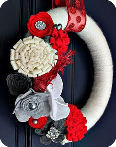 I love the many different Felt flowers on this Wreath! #feltflowers