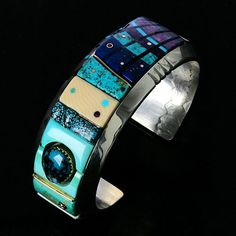 Cuff   Jeff Fulkerson. 'Spirit' Sterling silver, 14k and 18k gold, opal inlay, four kinds of turquoise, sugilite, fossilized ivory, coral, lapis, and diamond.