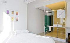 Style for Rent: Colombo and Serboli Architecture Renovate Barcelona Penthouse | Prints in the bedroom are by graphic artist Sigrid Calon. #interiordesignmagazine #projects #interiors #bedrooms