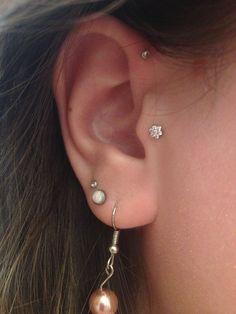 Industrial strength flower earring. Tragus piercing. Forward helix piercing.