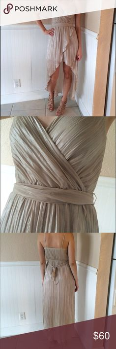 """Beautiful Silver Shimmer High/Low Dress Only worn once! Perfect condition! High/low dress. Beautiful color & sheen. It is long - I am 5'8"""", so if you are shorter than I am, it would be longer on you. Can be shipped in a garment bag. Express Dresses High Low"""