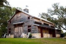 This traditional hand hewn English framed barn was originally built circa 1820. They kept the traditional barn look that's best personified by the 1x10 plank siding.