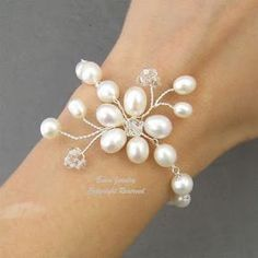 Recent water pearl vine floral bridal bracelet von adriajewelryWhite Pearl Bridal WEdding Bracelet Jewelry Fresh by eminjewelryto use ortho ligature wiresWhite Pearl braclet on etsy Delicate pearls turned into flowers make this bracelet perfect for w Bridesmaid Bracelet, Bridal Bracelet, Pearl Bracelet, Pearl Jewelry, Wire Jewelry, Jewelry Crafts, Wedding Jewelry, Beaded Jewelry, Handmade Jewelry