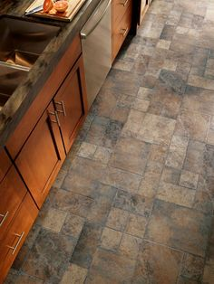 Armstrong Weathered Way floors in Euro Terracotta. Can you believe this is a laminate? With a beautiful range of colors this flooring fools everyone into thinking you spent a lot of money.