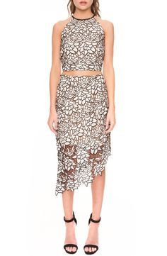 Creating a feminine and flirtatious look with this gorgeous two-piece set in black and white lace.