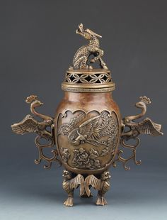 A RARE AND UNUSUAL PHOENIZ HANDLE BRONZE AROMATHERAPY. Qing Dynasty
