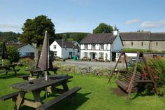 The Black Lion is a cosy and friendly village Pub. You can enjoy the woodland walks in the Brechfa Forest which follow the Gorlech River; either the short  or long signposted walks, or the highly regarded Brechfa Mountain Bike Trails; then retreat to the Pub and toast yourself by the fire in the Winter or relax in the Beer Garden by the River and enjoy the view in the Summer. Children, dogs and the occasional horse are all welcome. You can choose from an extensive bar menu and specials board…