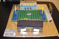 CanadInns Stadium in Winnipeg, home to the Winnipeg Blue Bombers. I create the field by making one big piece of gingerbread then using wax paper to keep the green sugar in the size of the field, add blue sugar for the end zones then draw the lines with royal icing.