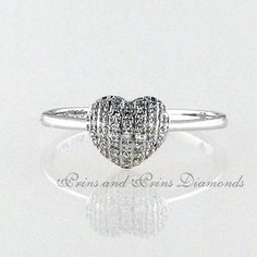 There are 43 = GH/VS – SI round cut diamonds multi pavé set in a white gold heart shaped design Heart Shaped Diamond Ring, Diamond Rings, Heart Ring, Dress Rings, Gold Heart, Heart Shapes, Diamonds, White Gold, Sparkle