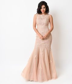 This elegant lace gown is painstakingly crafted in a dreamlike mermaid silhouette. It is form fitting and floor length with a sweetheart and lace neckline, outfitted with padding and flexible boning.