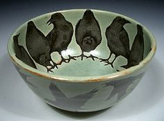 A ring of crows line the interior of this slightly ominous bowl, waiting for food to arrive. Outside, a flock of crows circle, equally anxious for a meal. This stoneware bowl is 6 wide and 3 high. Pottery Bowls, Ceramic Bowls, Ceramic Pottery, Pottery Art, Ceramic Art, Stoneware, Flock Of Crows, Crows Ravens, Hand Painted Pottery