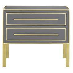 The Arden Chest is inspired by a 1970s reverse-painted glass antique found while in the Paris Flea Market. The chest features Tornado reverse- painted glass panels on the top, front and sides with solid brass trim, hardware and cladded legs. The chest is an image of simple luxury with its stormy gray hue, beveled top and drawers with soft close glides.  PRODUCT NAME: Arden Chest DIMENSIONS: 36w x 19d x 33h