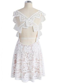 Make a little white noise at the spring soirees this year with our endearing lace dress. A shorter hemline keeps it youthful while the lace and exposed cross-back keep it fun and alluring. Style with metallic heels for a sparkling finish.  - Floral lace finished - Cross-straps to reverse - Open back - Eyelet detail - Concealed back zip closure - Lined - 100% polyester - Hand wash  Size(cm)Length Bust Waist   XS        92    86    76 S         93    90   …
