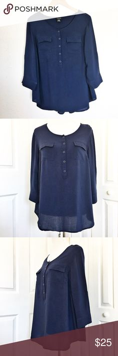 """Torrid Blouse This is a great staple piece by Torrid.  Navy blue in color with a half Button Up in the front and 3/4 sleeves.  Also has 2 function front flap pockets.  Material is 100% rayon.  Measurements laid flat: bust 22"""" and length from top of shoulder to hem 28"""".  Size 0 in Torrid is equal to an XL or size 12. torrid Tops Blouses"""