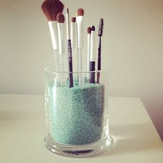 Reuse candle jars // To make a makeup brush holder, just use coloured sand or pebbles (the smaller the better as it will be easier to place brushes into) and fill up the jar. Probably could use epsom salts too.