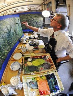 Museum artist Stephen C. Quinn paints a mural for a new exhibition opening this fall. Quinn has worked on dioramas here at the American Museum of Natural History for nearly 40 years. © AMNH/D. Finnin