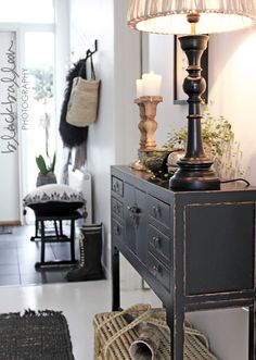Love the gray paint on this console, lamp, candlesticks, basket. Lots of great detail.