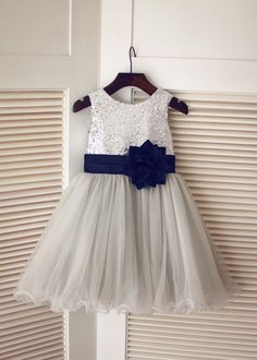 The materials for this dress is sequin,satin and tulle.The listed color is silver top,gray skirt with navy blue flower sash.The sash is folded and has a handmade flower at front.Love the curly hem for skirt.It is in knee length.Perfect for wedding party,prom,photo shoot,Easter or daily wear.For Cust