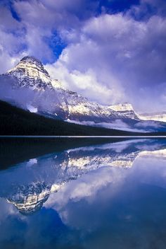 Clouds on Mount Chephren reflected in the Lower Waterfowl Lake. Banff National Park, Alberta, Canada.  Photo: Jerry Mercier via Flickr