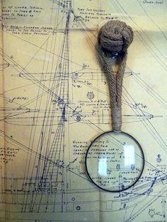 Olivia Harsham. ship blueprint. magnifying glass.