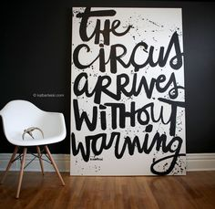 From the mysterious and spectacular #secretmasquerade art show - this oversized script painting is has the first line of the book Night Circus by Erin Morgenstern.