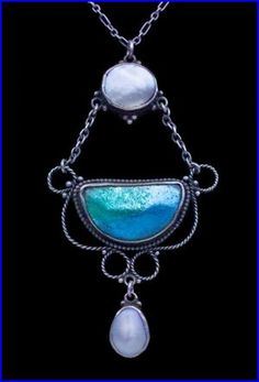 Newlyn (attrib.). Arts and Crafts pendant.  Silver, enamel and pearl. H: 5.9 cm (2.32 in)  W: 3.2 cm (1.26 in). British, c. 1910. Sold by Tadema Gallery. View 1.