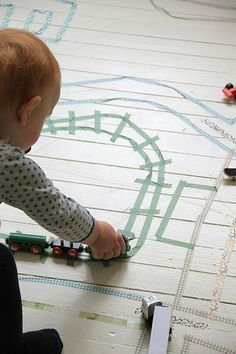 Make train tracks (or roads) on the floor with tape- a great boredom buster!