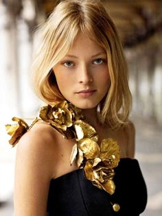Fake flowers turned glam with a can of gold spray paint.