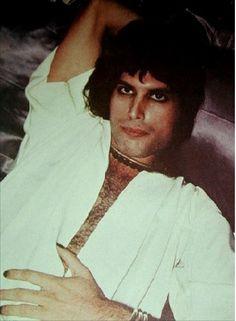 Freddie Mercury on his silky bed, by Mick Rock (1974)