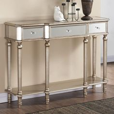 Infuse a touch of paradise into your home with the Eden console table from !nspire... http://worldwidehomefurnishingsinc.com/eden-console-table-in-silver.html