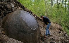 Mysterious giant sphere unearthed in forest divides opinion