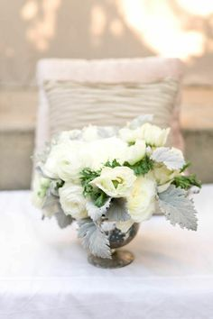 winter flowers: white roses and dusty miller. #centrepiece #florist