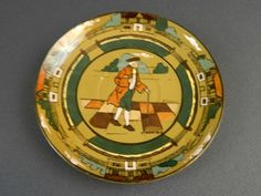 "Buffalo Deldare Pottery saucer. 6""wide."