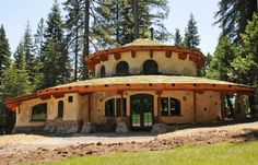 just neat-o. another straw bale home - this one in the round