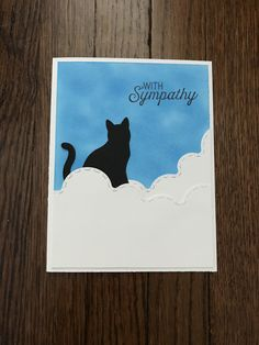 Pet Sympathy Card using Stampin Up cat punch and sentiment. Tim Holtz distress ink for the background. Cloud die cuts from CC Designs.