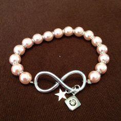 Armband zalmroze infinity http://www.mijnwebwinkel.nl/winkel/sieraden/c-3026900/producten/