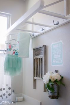 I'm always trying to figure out ways to make my laundry room more functional, and I've seen ladders hanging from the ceiling in laundry rooms so I decided to give it a whirl. My dad made the ladder, it's4 ft. x 17 in. with four 14 in. rungs, 1 ft. apart. He came up with...Read More …